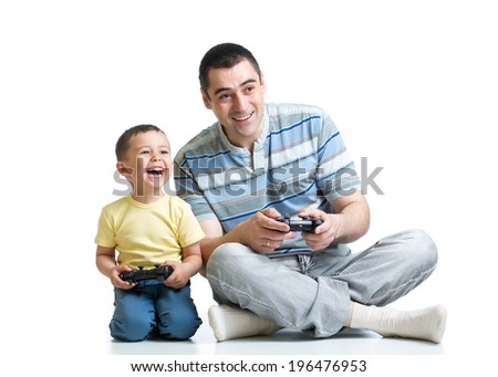 kid boy and his dad playing with a playstation together - stock photo