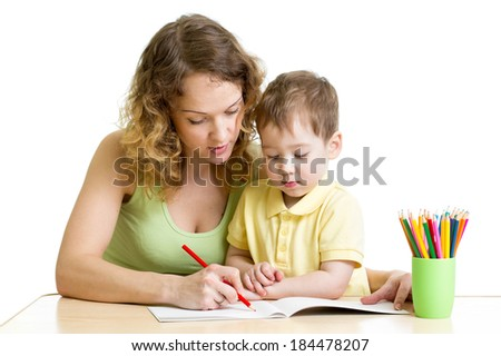kid boy and mother draw with colorful pencils - stock photo