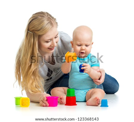 kid boy and mother playing together with cup toys - stock photo
