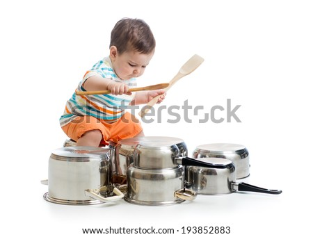 kid boy drumming playing with pots - stock photo