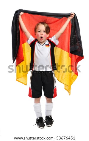 """Kid / Boy in complete german soccer outfit holding a german flag an sings """"ole ole ole ole"""" - stock photo"""
