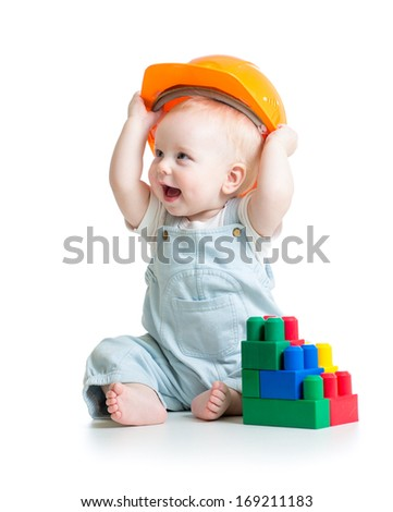 kid boy playing with building blocks toy - stock photo