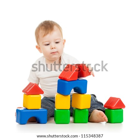 kid boy playing with construction set blocks isolated on white background - stock photo