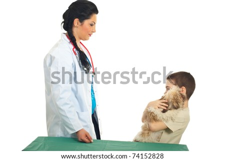 Kid boy with his puppy visit veterinary and having  conversation with doctor woman against white background - stock photo