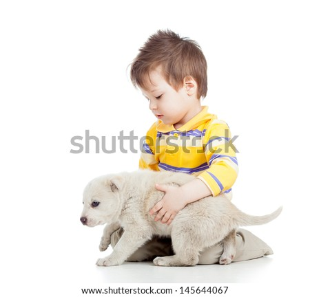 kid boy with puppy dog isolated on white background - stock photo