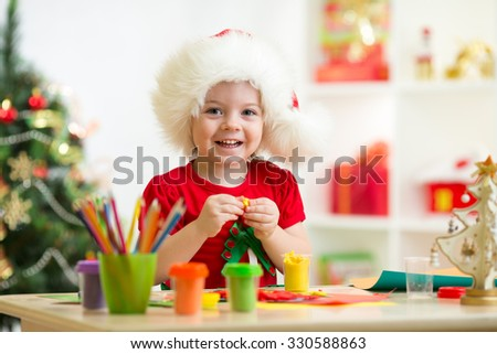 Kid child girl making by hands x-mas decorations - stock photo