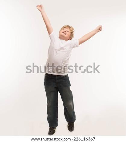 kid child studio boy portrait on white is jumping - stock photo
