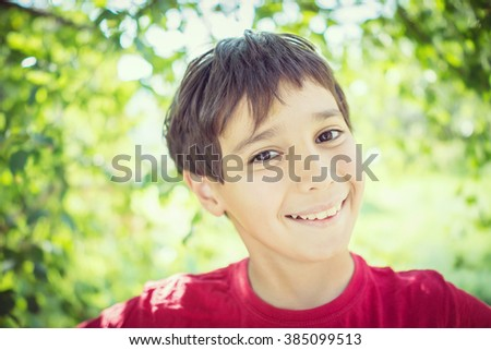 Kid closeup portrait outdoors - stock photo
