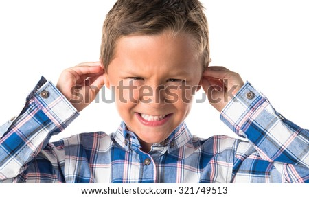 Kid covering his ears  - stock photo