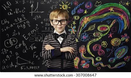 Kid Creativity Education Concept, Child Learning Art Mathematics Formula, School Boy Ideas on Black Chalk Board - stock photo