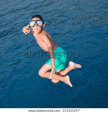 kid diving into the sea - stock photo