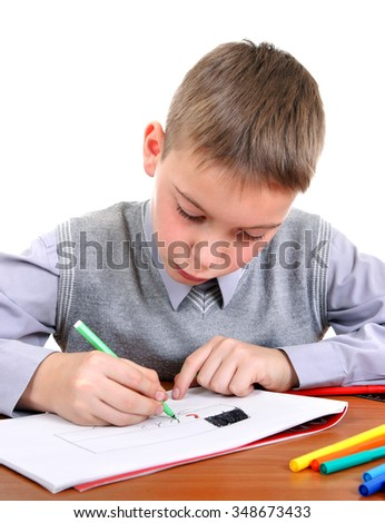 Kid Drawing at the School Desk Isolated on the White Background - stock photo