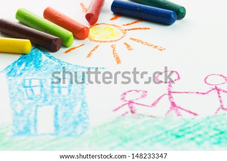 Kid drawing family near their house picture using crayons - stock photo
