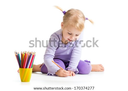 kid drawing with color pencils - stock photo