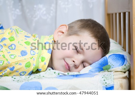 Kid dreams of sweet dreams, and fairy worlds - stock photo
