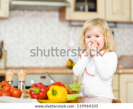 Kid eating healthy vegetables meal in the kitchen - stock photo