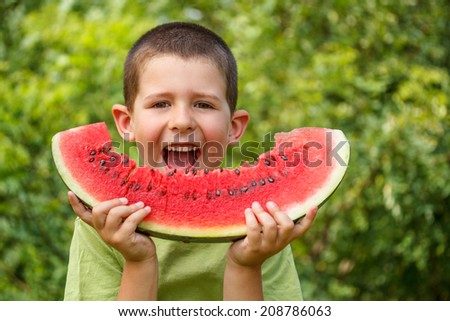 Kid eating red ripe watermelon - stock photo