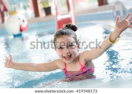 Kid Enjoying Swimming in The Pool - stock photo