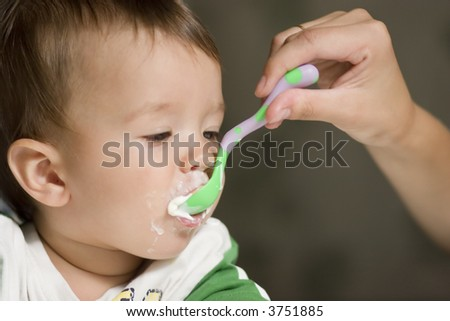 Kid feeding - stock photo