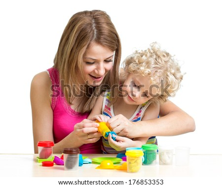 kid girl and mother play colorful clay toy - stock photo