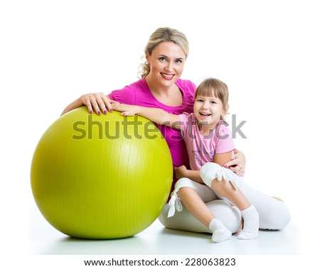kid girl and mother with fitness ball - stock photo