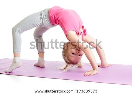 kid girl doing gymnastics on fitness mat - stock photo