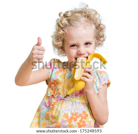 kid girl eating banana and showing ok sign - stock photo