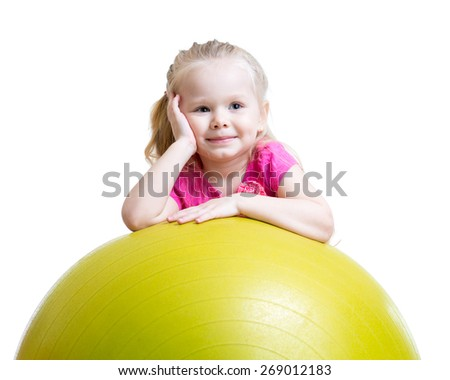 Kid girl having fun with gymnastic ball isolated - stock photo