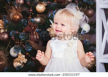 kid girl near Christmas tree  - stock photo