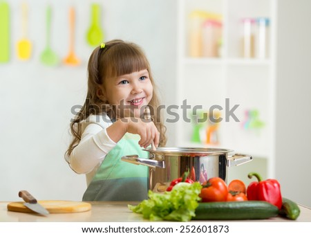 kid girl playing cook and preparing healthy food - stock photo