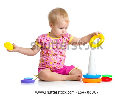 kid girl playing pyramid toy - stock photo
