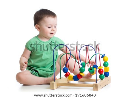 kid girl playing with educational toy - stock photo