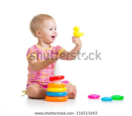kid girl playing with toy isolated on white background - stock photo