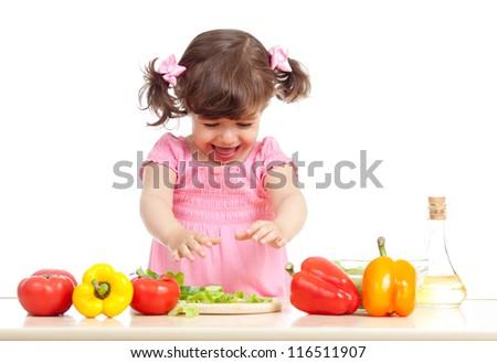 kid girl preparing vegetable salad. Concept of healthy food. - stock photo