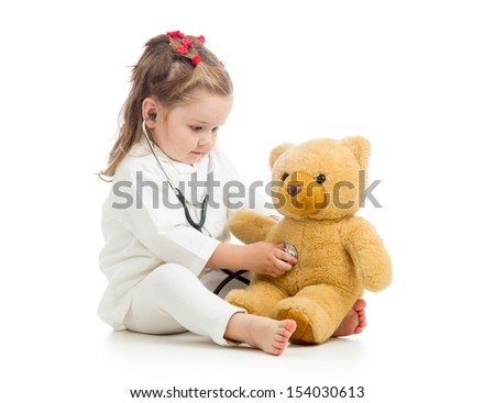 kid girl with clothes of doctor playing with toy - stock photo