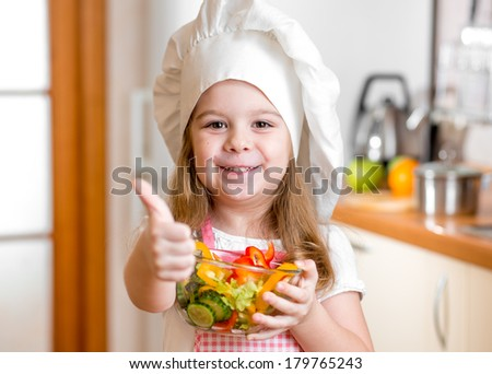Kid girl with healthy food and showing thumb up - stock photo