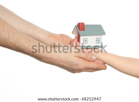 kid give model of home to adult - stock photo