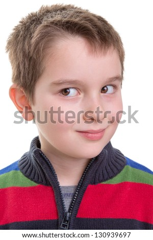 Kid giving a mischievous side look. Wonder what he thinks. - stock photo