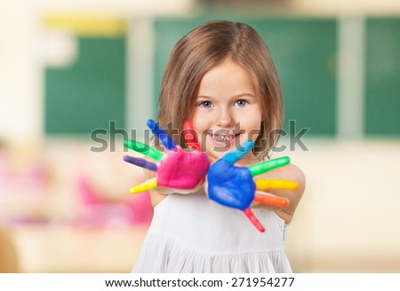 Kid. Happy kid playing with paints in his fingers. - stock photo