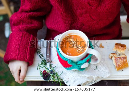 Kid holding a Mug of Tomato Soup with Seeds.  - stock photo