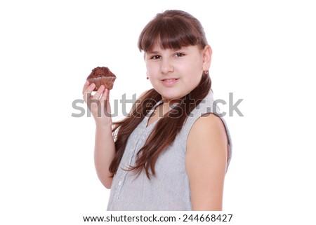 kid holding chocolate cupcake - stock photo