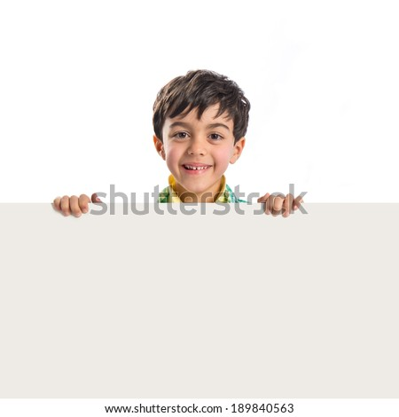 Kid holding empty placard over white background  - stock photo