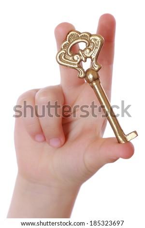 kid holding vintage old key - stock photo