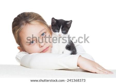 kid hugging a cute little kitten - stock photo