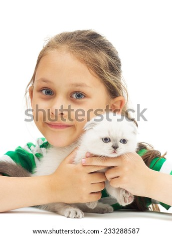 kid hugs British lop-eared kitten on a white background isolated - stock photo