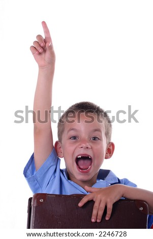 Kid in primary school eager to answer question - stock photo