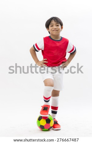 Kid in sportswear holding a soccer ball isolated on white background - stock photo
