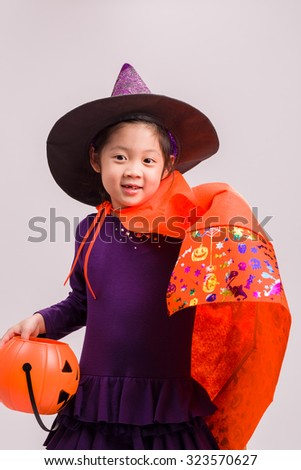 Kid in Witch Costume on White / Kid in Witch Costume / Kid in Witch Costume, Studio Shot - stock photo