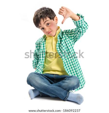 Kid making bad sign over white background  - stock photo