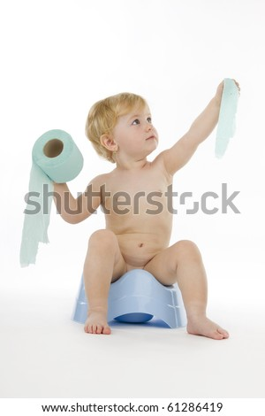 Kid on chamber pot and toilet paper, on white background. - stock photo